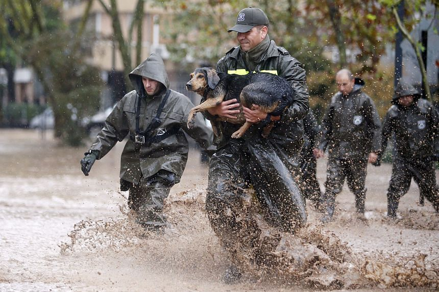 Heavy flooding has also affected parts of South America. In Chile, a policeman rescues a dog during a downpour in the capital Santiago. Four days of rain, which intensified over the weekend, sent water tumbling off the Andes mountains and into Santiago, c