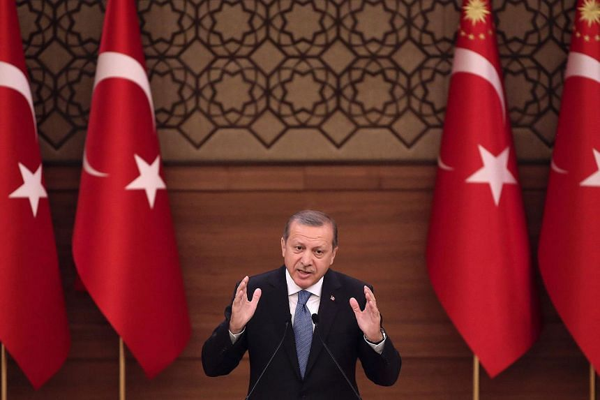 Turkey's President Recep Tayyip Erdogan delivering a speech during the mukhtars meeting at the Presidential Complex in Ankara on April 19, 2016.