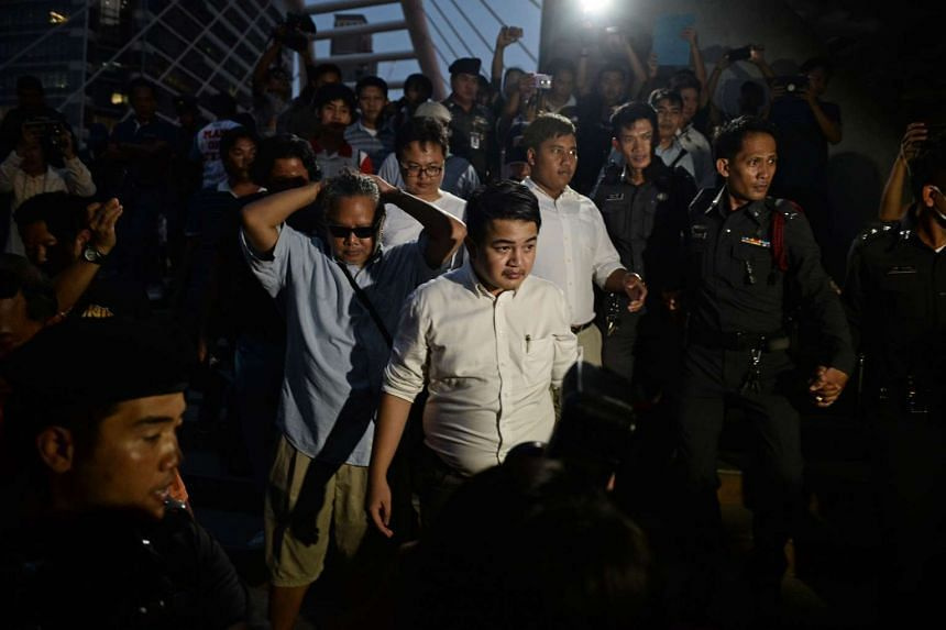 Police arrest activists for defying the ban on public gatherings, and for protesting against the detainment of Wattana Muangsuk, on April 20, 2016.