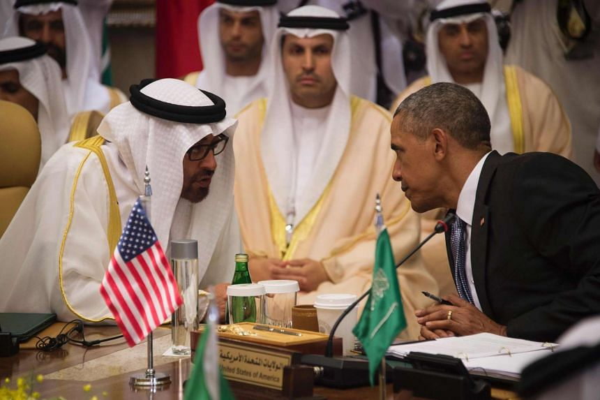 US President Barack Obama (right) speaks with Sheikh Mohammed bin Zayed al-Nahyan, Crown Prince of Abu Dhabi, during the US-Gulf Cooperation Council Summit in Riyadh, on April 21, 2016.