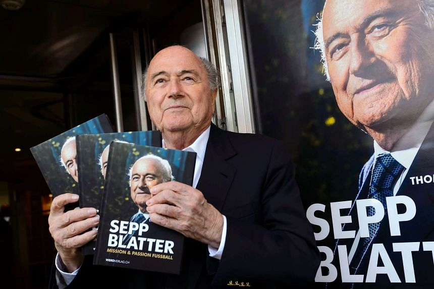 Fifa's ex-president Sepp Blatter poses with a copy of his biography during the book's presentation in Zurich, on April 21, 2016.