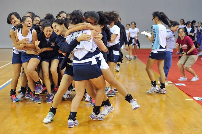 Girls from CHIJ Secondary School celebrating after winning the National Inter-School Netball Championships 2016 'B' Division Finals against Dunman Secondary School on April 21, 2016.