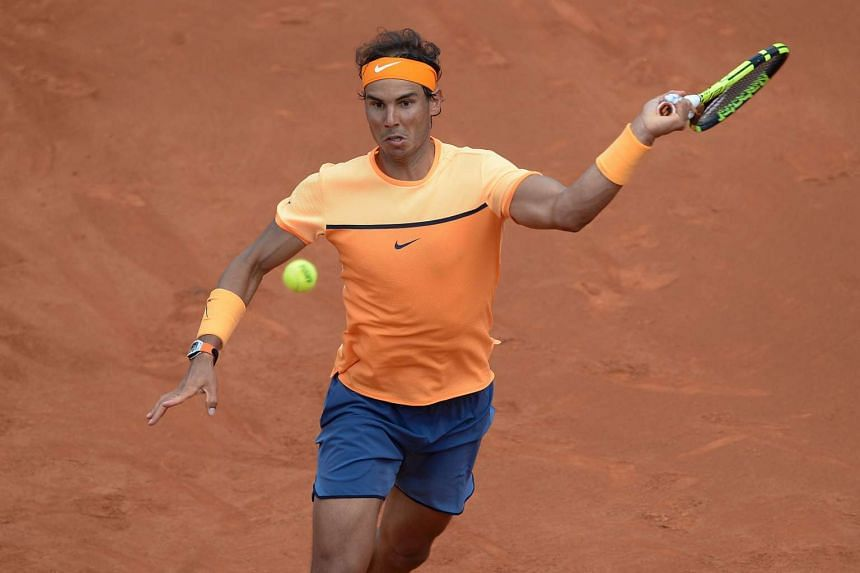 Spain's Rafael Nadal returns the ball to Spain's Albert Montanes during the ATP Barcelona Open, on April 21, 2016.