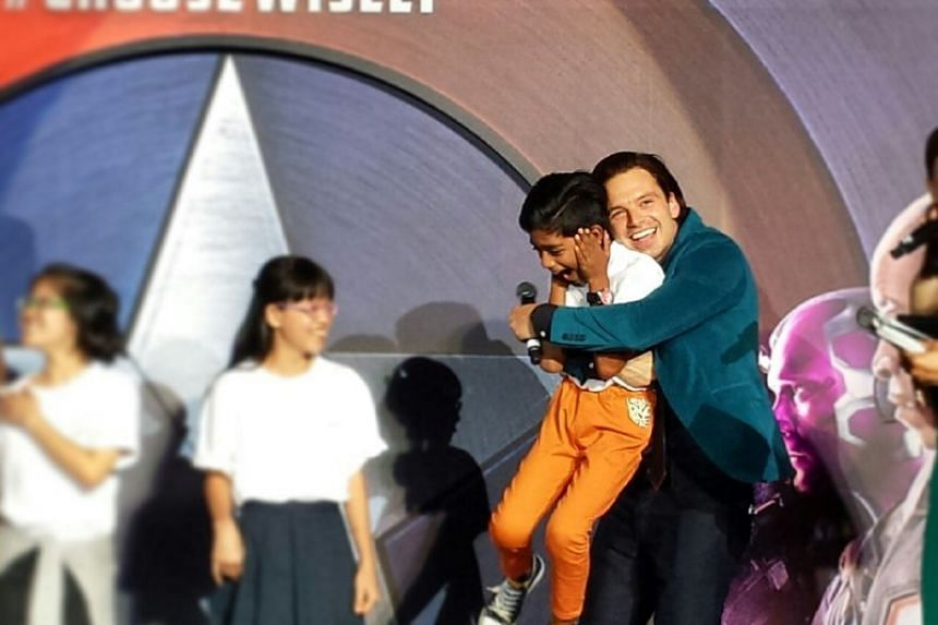 Actor Sebastian Stan, who plays Captain America's best friend Bucky Barnes in the movie, gives a young fan a big hug at the MBS event.