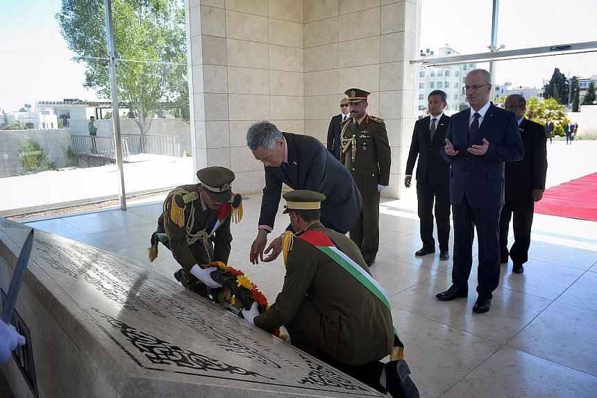 Prime Minister Lee Hsien Loong placing a wreath at the mausoleum of the first Palestinian Authority president, Mr Yasser Arafat, in Ramallah yesterday. He was accompanied by Palestinian Prime Minister Rami Hamdallah, Foreign Minister Vivian Balakrish