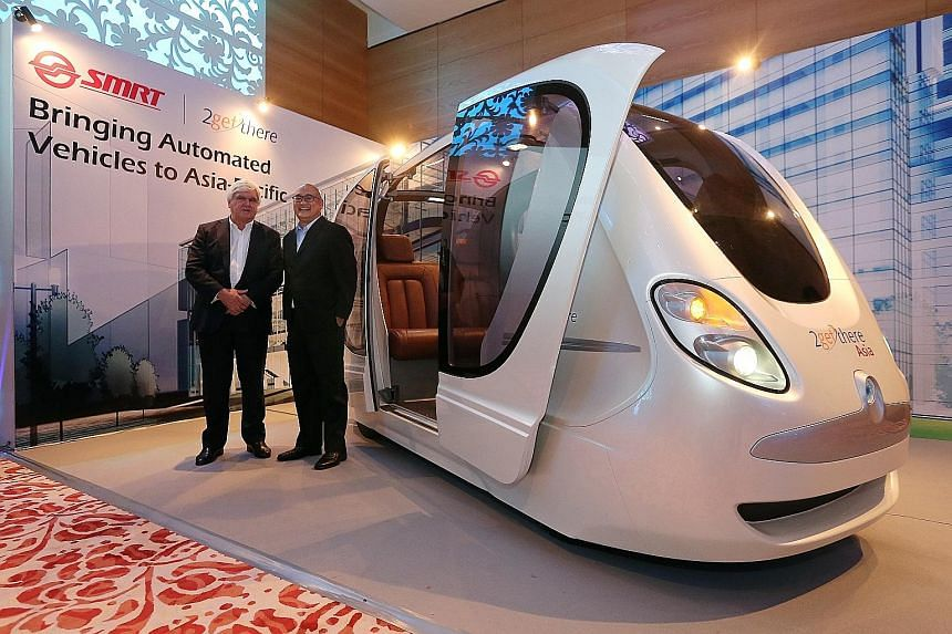 2getthere's Mr van Helsdingen (above, left) and SMRT Services' Mr Lim (right) with a replica of the personal rapid transit system, which can seat four people (below). The group rapid transit system has bigger 24-passenger pods.