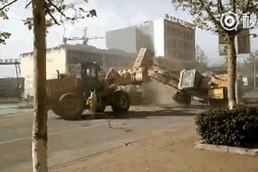 A still from the video of the street battle in China's Hebei province fought with construction equipment.
