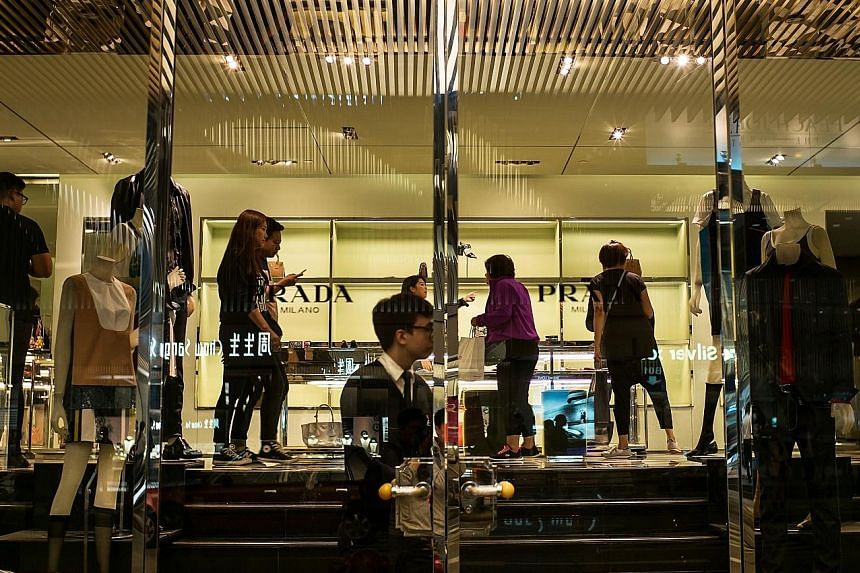 The Italian luxury goods-maker, which opened too many stores in Asia, plans to curb expansion and offer a larger range of goods online.