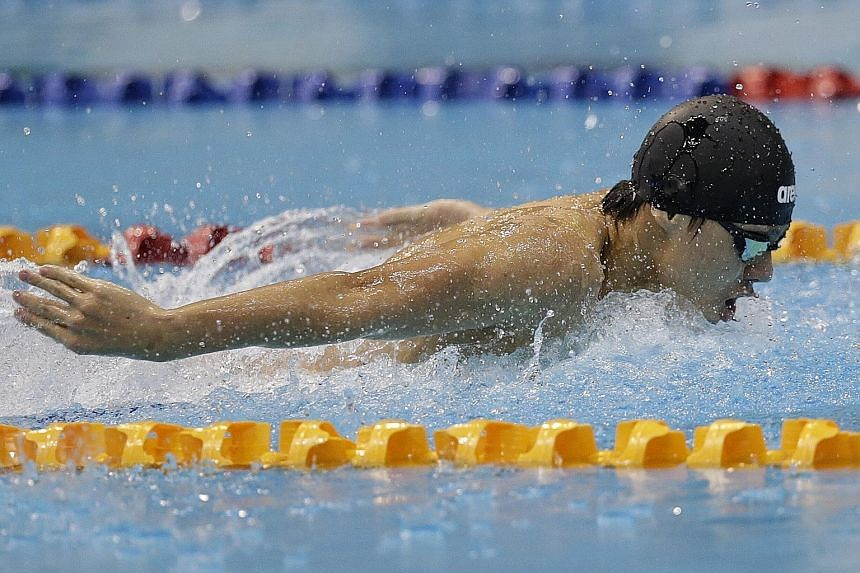 Dylan Koo on his way to clocking a meet record of 54.30sec in the boys' A Division 100m butterfly. He and three other ACS(I) swimmers - Francis Fong, Mikkel Lee and Darren Chua - each won four golds.