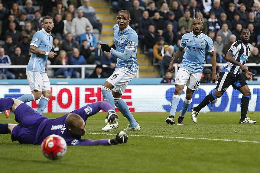 Vurnon Anita (right) scoring his first goal in over two years to equalise for Newcastle against Man City. The Magpies are in a relegation dog-fight with Norwich and Sunderland.
