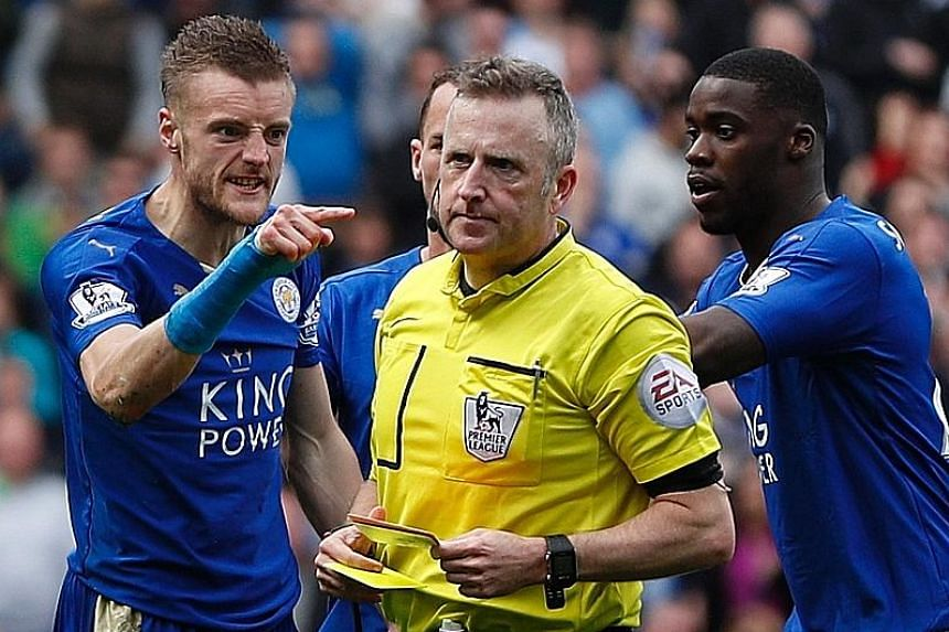 Leicester City's Jamie Vardy gave Jonathan Moss a piece of his mind after the referee showed the striker his second yellow card for simulation during the Foxes' draw with West Ham. Moss' controversial performance has increased the scrutiny on the cho