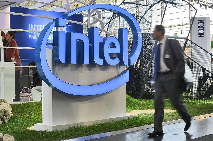 Intel Corp's stand at the CeBIT computer show in Germany last month. The chipmaker's job cutback - its deepest in a decade - is a radical step taken to move into new businesses and ease its dependence on the shrinking PC market.