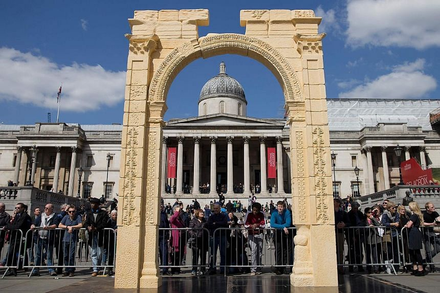 A replica of the destroyed Arch of Triumph in Syria's city of Palmyra, set in front of the National Portrait Gallery, after being unveiled on Tuesday to a crowd of hundreds in Trafalgar Square in central London. The original arch was blown up by the