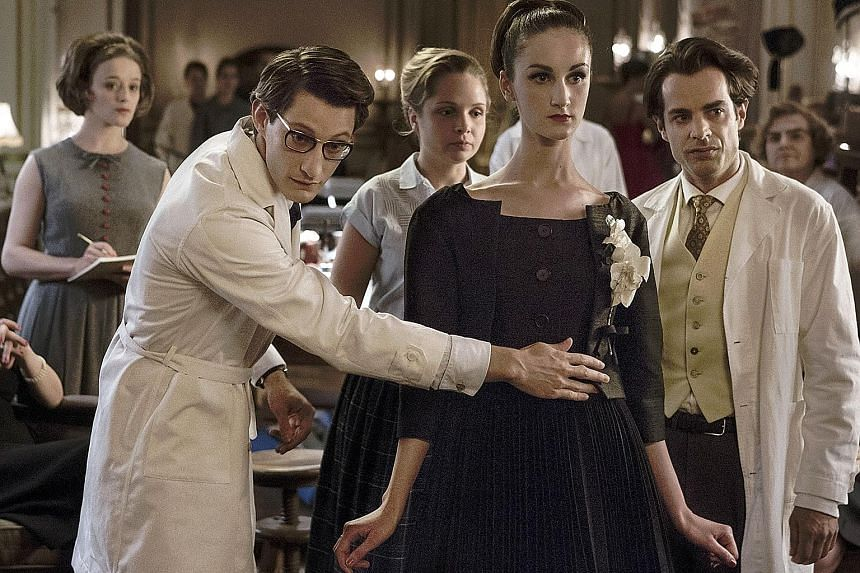 Pierre Niney (left) plays Yves Saint Laurent in the biographical film about the French fashion designer.