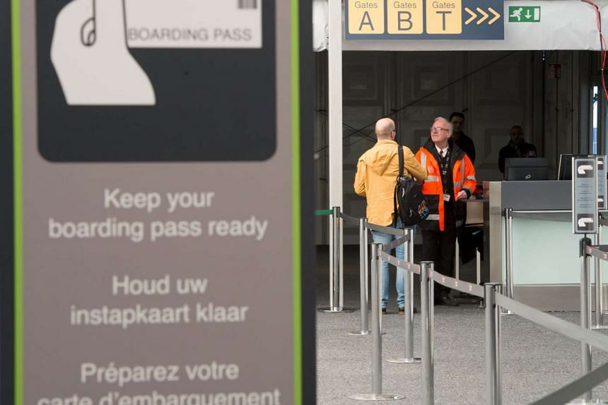 A passenger arrives at Brussels Airport, partially re-opened following a bomb blast in Zaventem, Belgium.