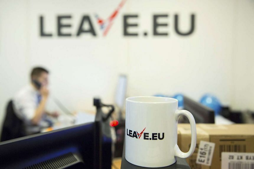 A worker answers a telephone in the office of Brexit group pressure group Leave.eu in London, Britain. The City of London Corporation has warned that London will lose its global financial centre status should it leave the European Union.