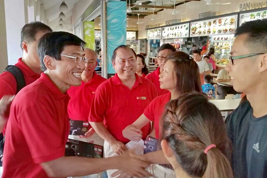 Singapore Democratic Party chief Chee Soon Juan greeting residents at a Bukit Batok coffee shop during his walkabout on April 21, 2016.