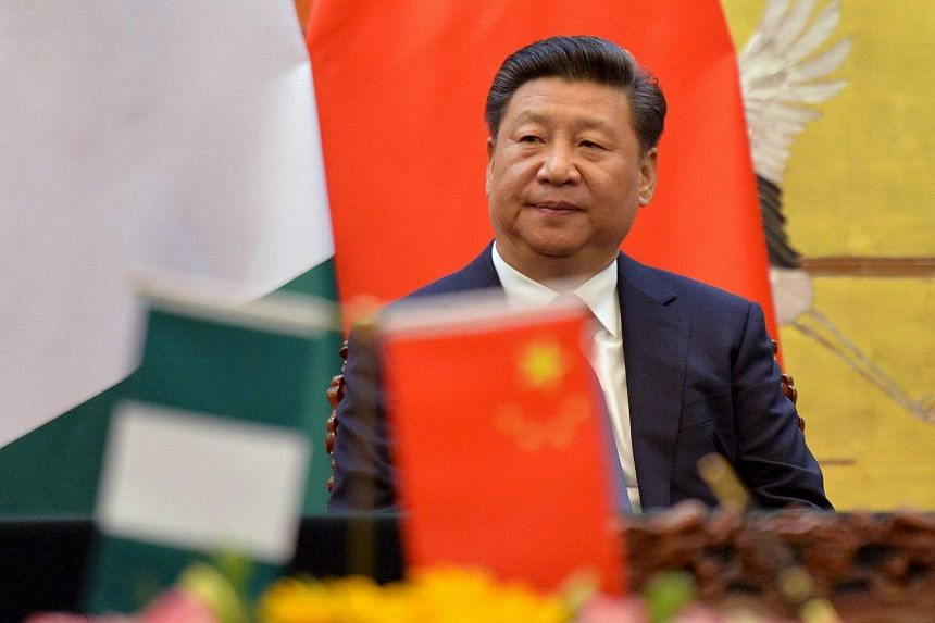 Chinese President, Xi Jinping attends a signing ceremony with President of the Federal Republic of Nigeria, Muhammadu Buhari (not pictured) at the Great Hall of the People in Beijing.