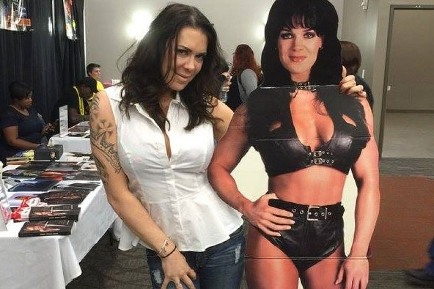 Former WWE star Chyna posing with her standee at an undated fan convention.