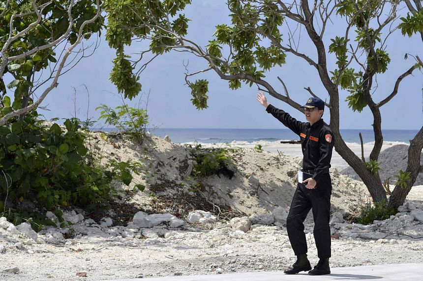 A member of Taiwan's coast guard speaks as he guides visiting journalists on Taiping island in the Spratlys chain in the South China Sea.