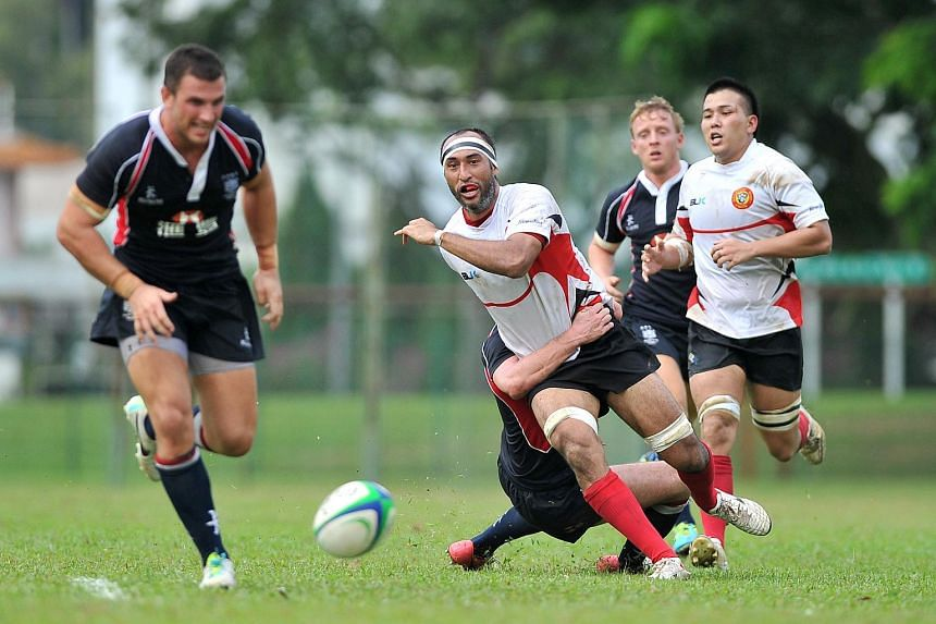 Singapore's Daniel Marc Chow (centre, in white) playing against Hong Kong in 2013.
