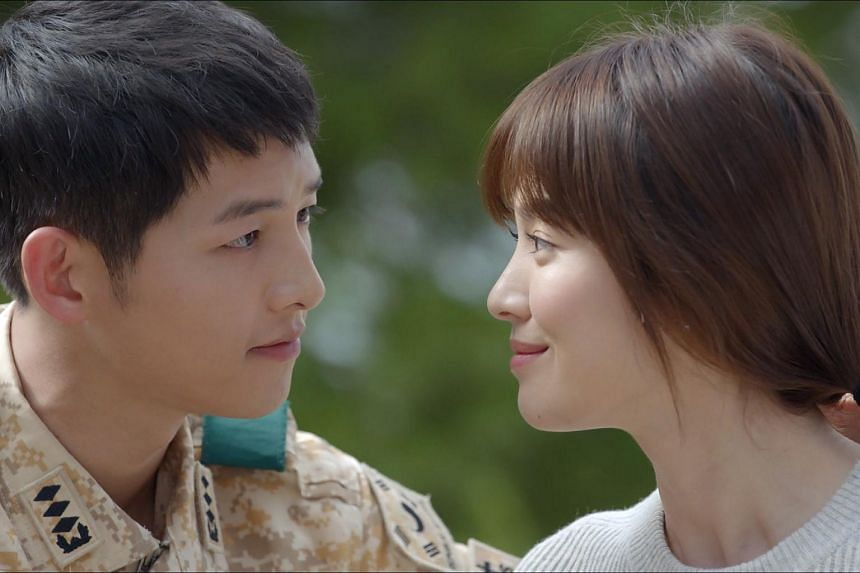 Television still from Descendants Of The Sun starring Song Joong Ki (left) and Song Hye Ko.