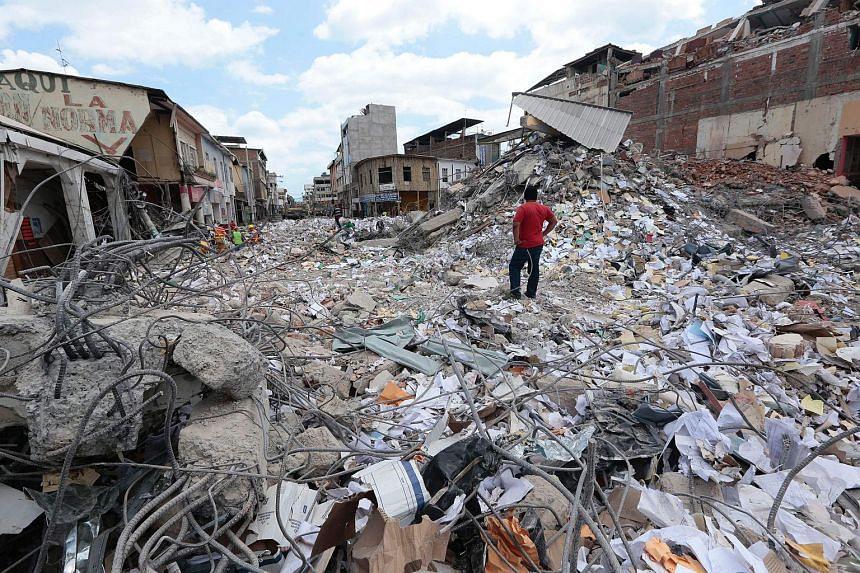 A man stares at the rubble in Portoviejo, Ecuador on April 20, 2016.