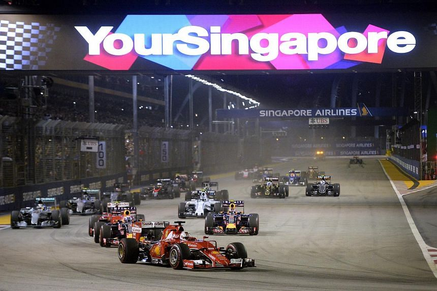 Ferrari Formula One driver Sebastian Vettel of Germany leads the field during the Singapore F1 Grand Prix 2015.