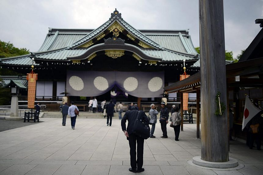 A visitor bowing after he offered prayers at Yasukuni Shrine in Tokyo, Japan.