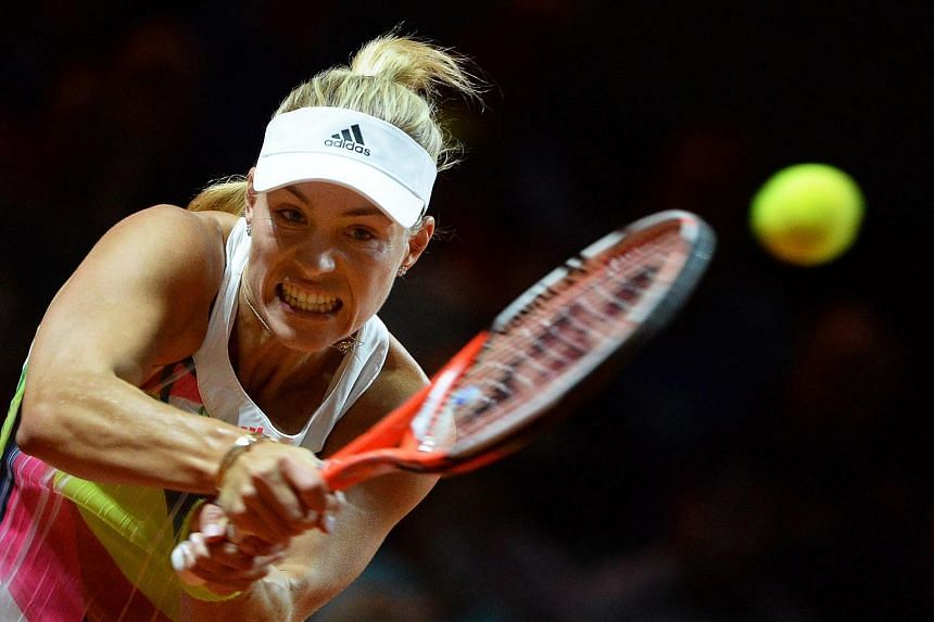 Angelique Kerber returns the ball to Annika Beck during their second round match of the WTA tennis tournament in Stuttgart, Germany, on April 20, 2016.