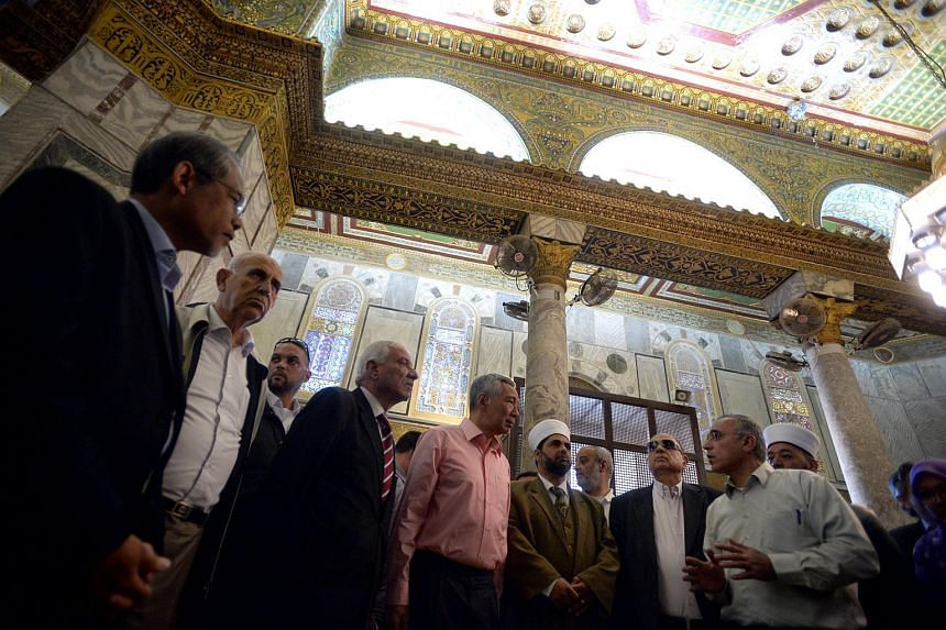 Mr Lee and Environment and Water Resources Minister Masagos Zulkifli (far left) at The Dome of the Rock.