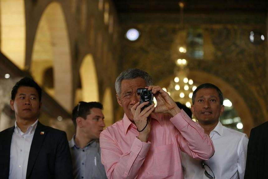 Mr Lee taking a picture as he stands inside Al-Aqsa mosque in the old city of Jerusalem.