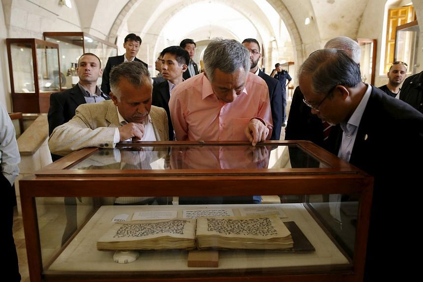 Mr Lee looking at a Koran on display at a museum in Temple Mount.