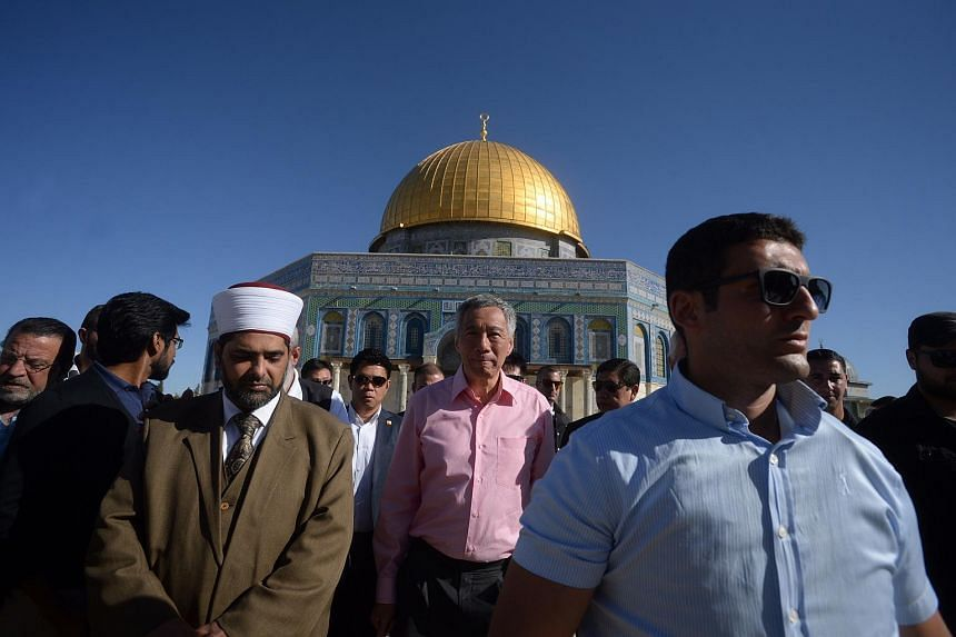 Prime Minister Lee Hsien Loong walking along the outskirts of The Dome of the Rock, a Muslim shrine located at the Temple Mount in Jerusalem.