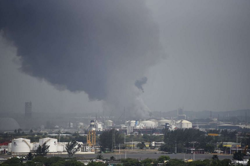 Smoke rises from the explosion site at Mexican national oil company Pemex's Pajaritos petrochemical complex in Coatzacoalcos, Mexico.