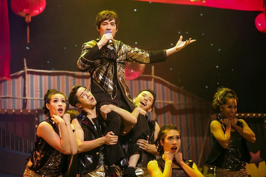 Getai singer Desmond Ng (carried by ensemble) stars in Ge Tai The Musical, a production staged by Resorts World Sentosa.