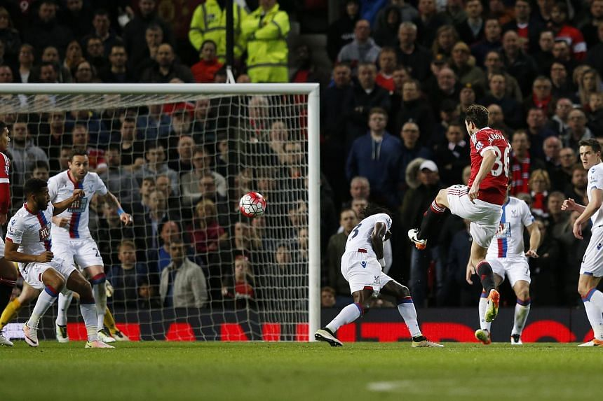 Manchester United's Matteo Darmian scores their second goal against Crystal Palace.