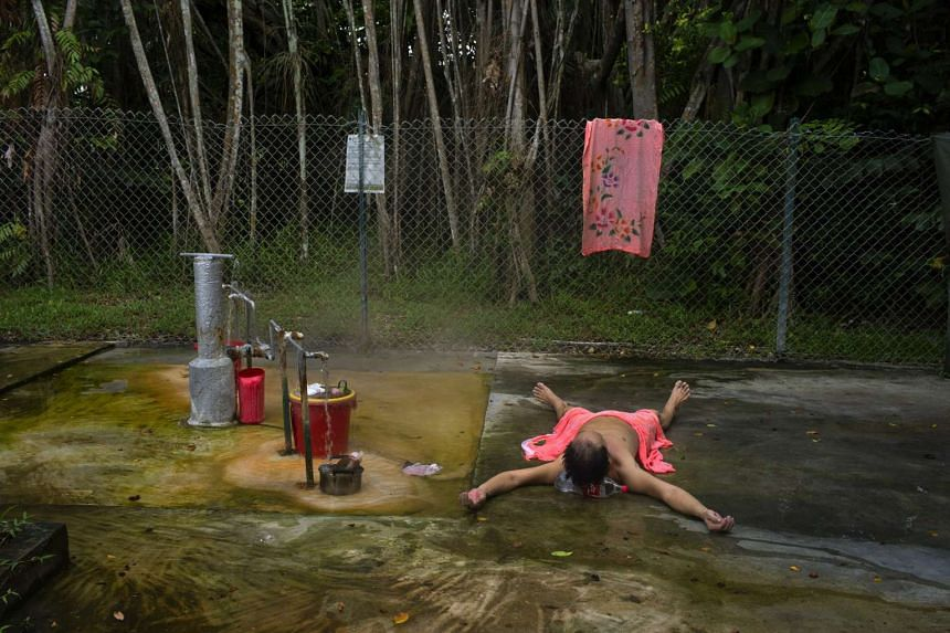 An image of Sembawang Hot Spring by Graciela Magnoni (above) and another of a foreign worker in Singapore by Jimmy Sng.