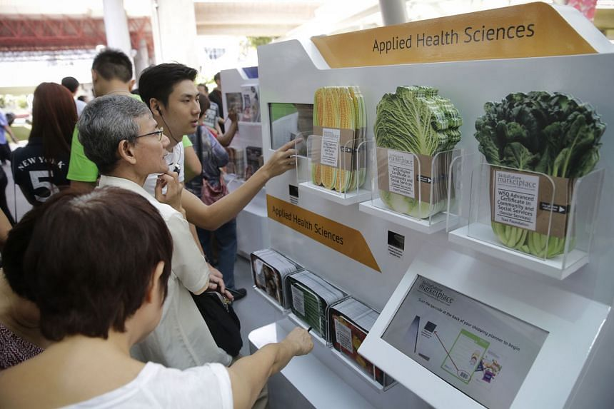 Visitors at the inaugural SkillsFuture roadshow at Westgate mall on Jan 9. SkillsFuture is everything we do to create a future that is different and better than today, says Acting Education Minister Ong Ye Kung.