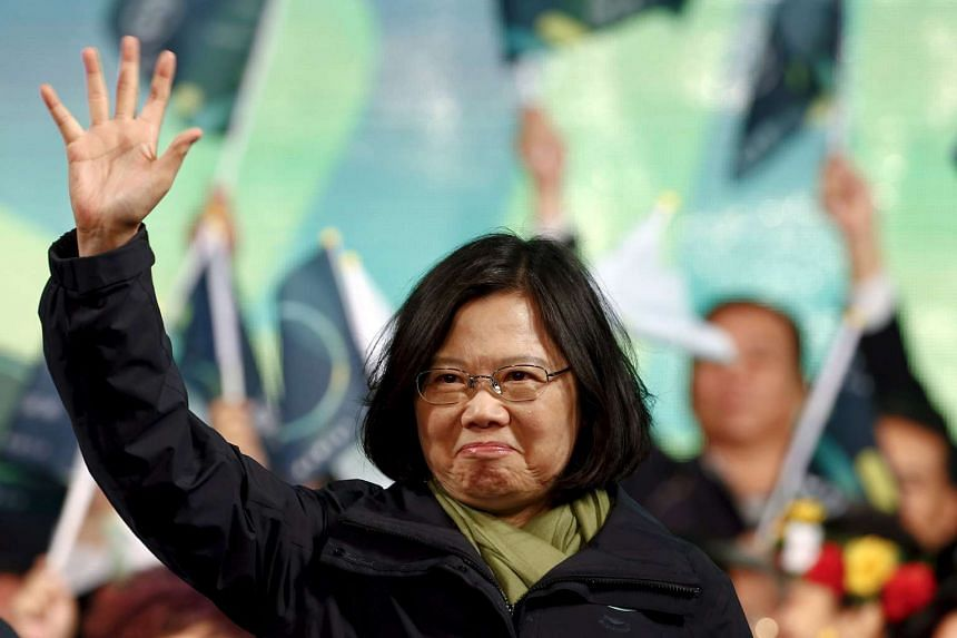 Tsai Ing-wen greets supporters after her election victory at party headquarters in Taipei.