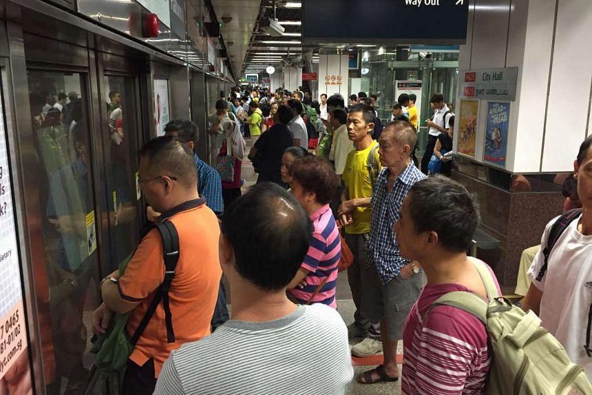 Commuters waiting in vain for the train at City Hall MRT station at around 6.35am.