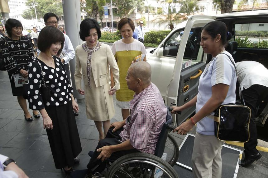 Mr Seah See Seng, a 62-year-old patient with HNF and accompanied 50-year-old HNF nurse clinician M. Kanagarani (right), meets Senior Minister of State for Health Amy Khor (left) and HNF president Priscylla Shaw (second from left) after arriving in a
