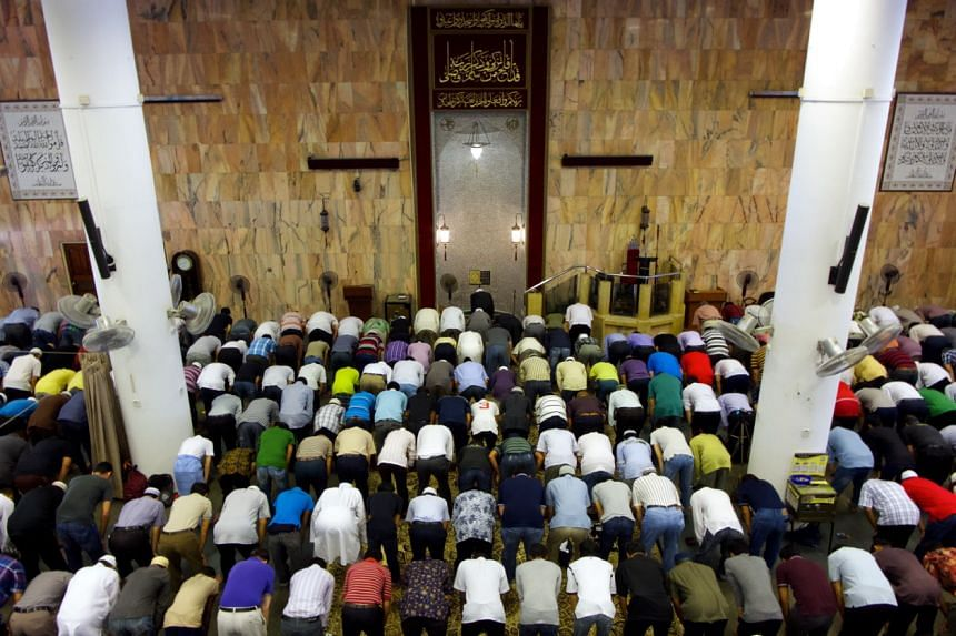 Muslim worshippers at a 'Tarawih' prayers at Al-Falah Mosque in 2014, before renovation works began.