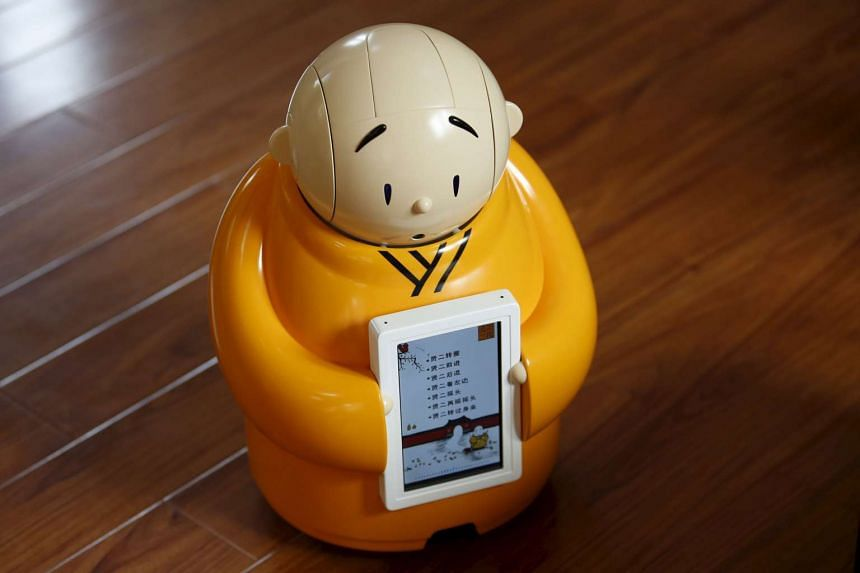Robot monk Xian'er at Longquan Buddhist temple on the outskirts of Beijing, on April 20, 2016.