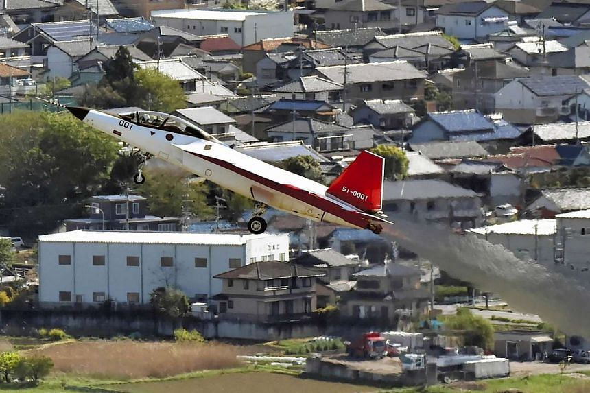 The X-2 advanced technological demonstrator plane of the Japanese Air Self-Defence Force takes off at Komaki Airport, on April 22, 2016.