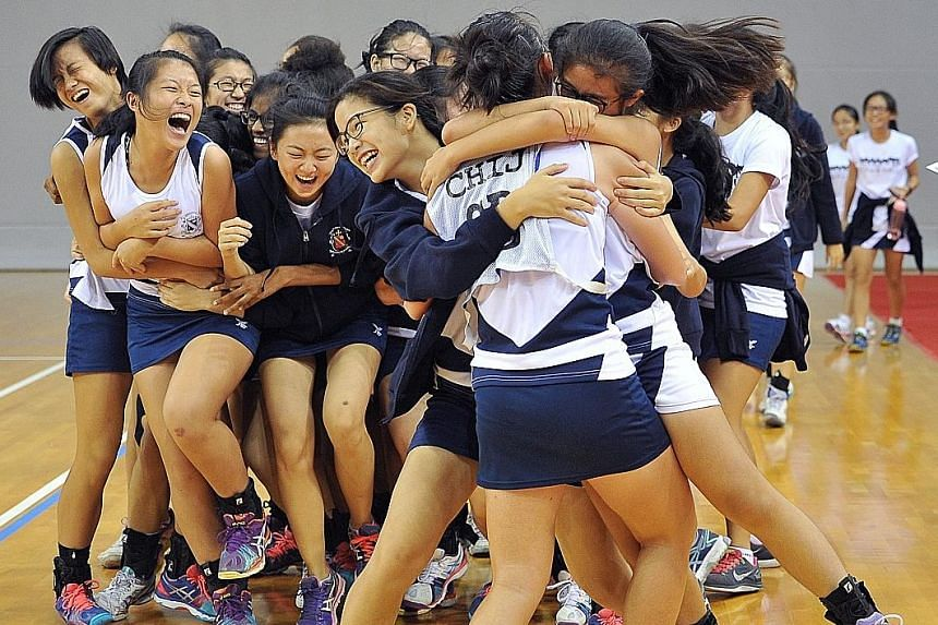 CHIJ Secondary's jubilant netball players celebrate after clinching both the B and C Division titles for the second year running. They beat Dunman Secondary 36-23 in the B Division final, and the Singapore Sports School 39-19 in the C Division final.