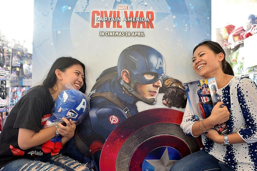 Quek siblings Gabriel, seven, and Hannah, 13, posing at the green-screen photobooth at Marvel's Captain America: Civil War Festival. Ms Aliefaini Pryanisa (left) and her aunt Fivi Mannell came from Jakarta to see the Team Cap cast.