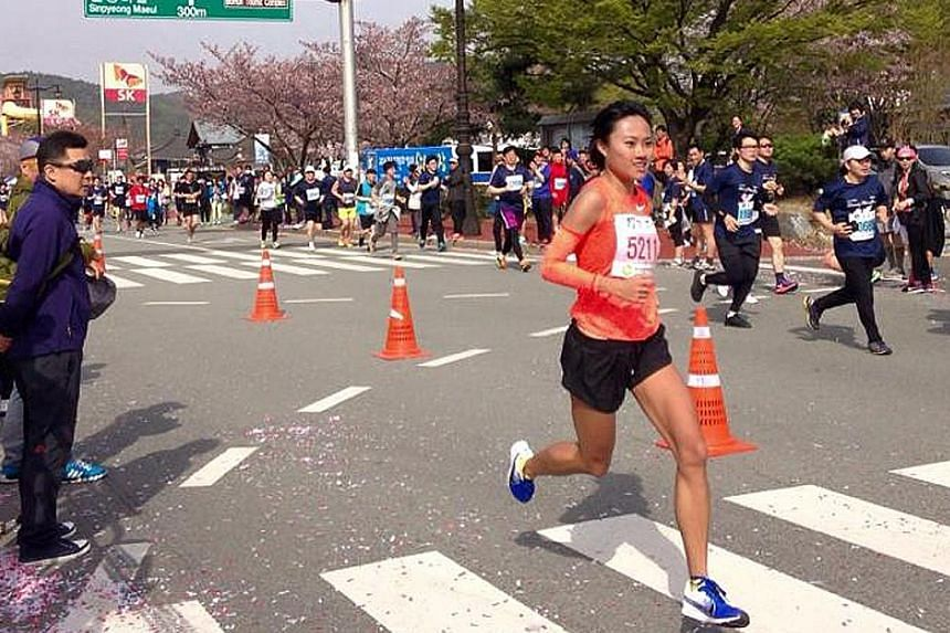 Mok Ying Rong racing in the Gyeongju Cherry Blossom Half Marathon on April 9. She set a new national best time of 1:23:14 after winning the Women's Open category.