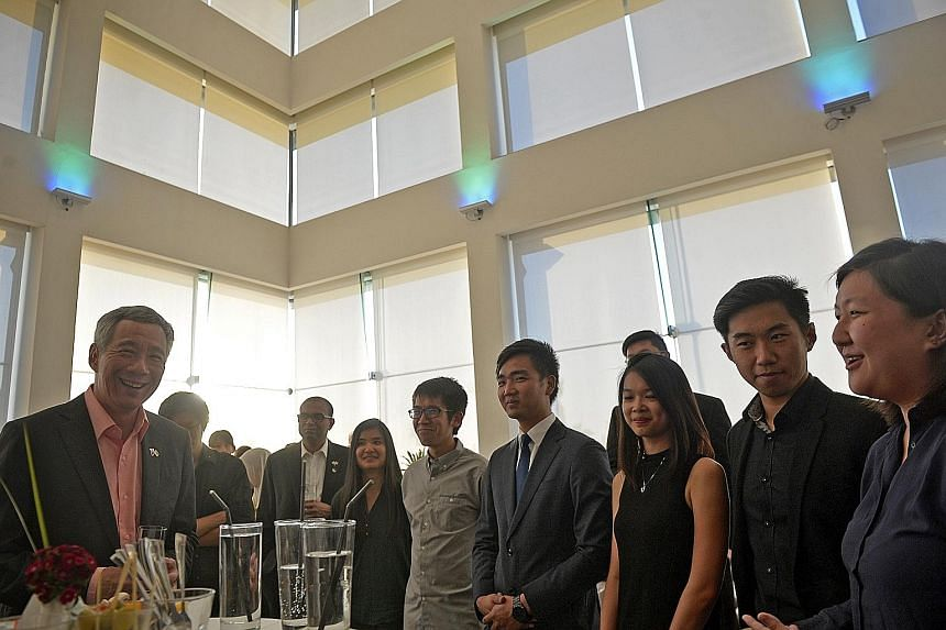 PM Lee meeting National University of Singapore students based in Tel Aviv, Israel, on Wednesday. Also at the meeting was Minister of State for Communications and Information and Education Janil Puthucheary (third from left). PM Lee's week-long visit