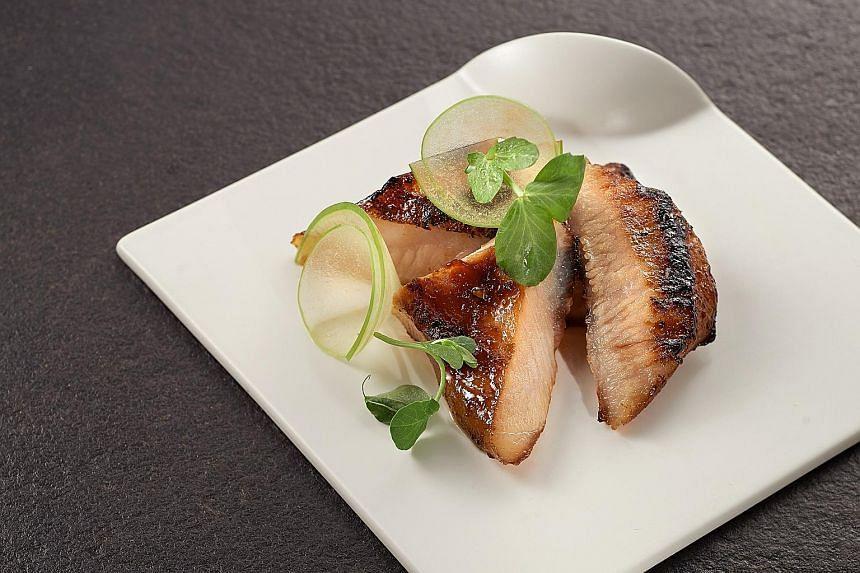 Grilled Iberico pork jowl ($12) from Mo'Mor Izakaya Tapas & Grill.